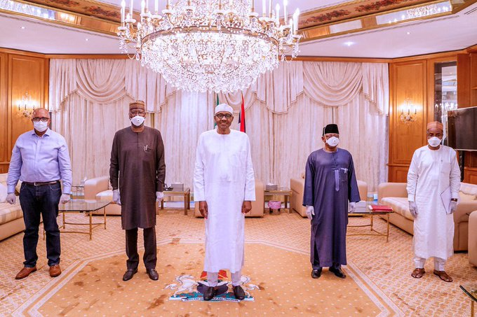 President Buhari not wearing face mask